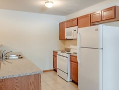 White appliances and Granite Countertops in Select Homes