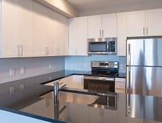 Kitchens complete with high-end finishes including stainless steel appliances, granite countertops, and glass backsplashes