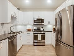 Modern kitchen features stainless steel appliances, quartz countertops, french door refrigerator and designer cabinets