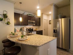 Granite Countertops with Tile Backsplashes and Stainless Steel Appliances