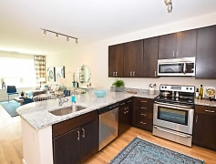 Gorgeous Kitchen with Stainless Steel Appliances and Granite Counter Tops