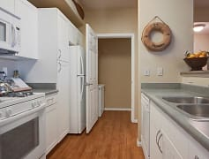 Galley Style Kitchen with Laundry Room just steps away