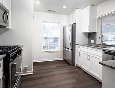 Newly renovated kitchen with stainless steel appliances, tile backsplash, and new cabinetry (in select homes)