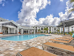 Coralina Apartments - Cape Coral, FL - Island-Style Lagoon Pool