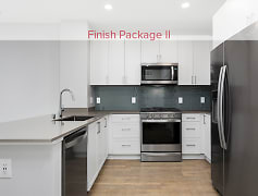 Kitchen with quartz stone countertops, stainless appliances, and hard surface flooring