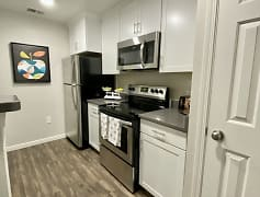 Kitchen equipped with fridge, oven, dishwasher, microwave, pantry and garbage disposal