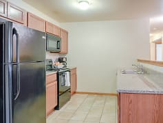 Rockridge Kitchen with Full Appliance Package, Including Refrigerator, Microwave, Range, Dishwasher and Double Sinks