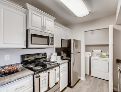 Kitchens featuring black fusion counter-tops, white cabinetry, and stainless steel appliances.