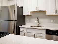 Upgraded kitchens with stainless steel appliances and white quartz countertops