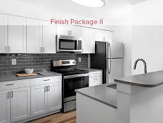 Finish Package II kitchen with quartz countertops, tile backsplash, and stainless appliances