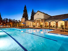 Heated swimming pool with spa