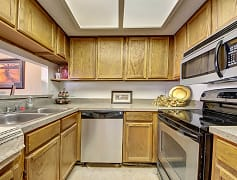A kitchen with lots of cabinet storage and stainless steel appliances