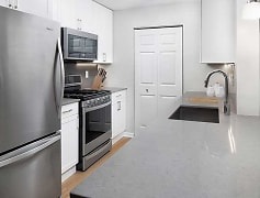 Kitchen with quartz countertops, new cabinetry, and stainless steel appliances