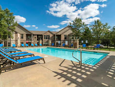 On a hot day, you'll love taking a dip in the pool and relaxing in the lounge chairs.