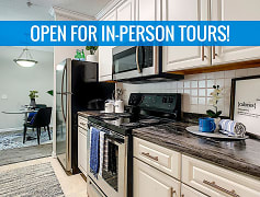Newly renovated kitchens featuring black-fusion counter tops, white cabinetry, and wood-style flooring. We are excited to offer in-person tours while following social distancing and we encourage all visitors to wear a face covering.