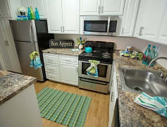 Newly remodeled kitchen with updated cabinetry featuring brushed nickel hardware & granite-style countertops.