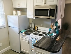 Your new kitchen has plenty of cabinet space and a small breakfast bar.