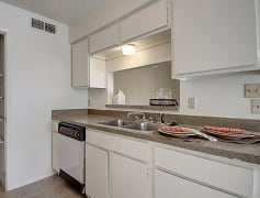 A kitchen with a large pantry and breakfast bar