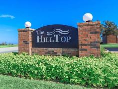 Hilltop Apartments with lush landscape
