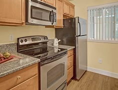Kitchen with stainless steel oven, stove, refrigerator and microwave
