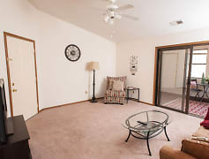 Living room with ceiling fan at Valley Stream Apartments in Maumee, OH