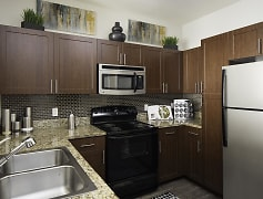 Designer kitchens with granite countertops with black and stainless appliances