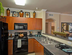 Rich cherry cabinets give your kitchen an elegant feel