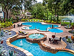 Lay by our relaxing pool with running fountains.