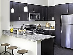 Gourmet kitchens at Skye provide all new black and silver appliances including gas range stoves.