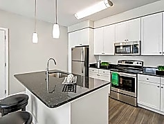 White Shaker Cabinets with Granite Countertops