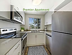 Premier kitchen with quartz countertops, stainless steel appliances, new cabinetry, and hard surface plank flooring (in select homes)