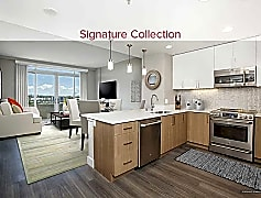 Signature Collection Kitchen, Living, and Dining Area with Hard Surface Vinyl Plank Flooring