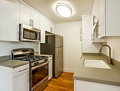 Modern kitchen featuring stainless steel appliances and quartz countertops