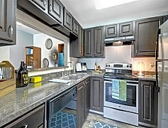 Newly renovated kitchens with silver appliances as well as new counters and cabinets