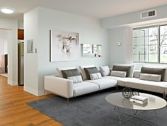 Spacious living room provides ample natural light