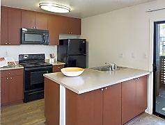 Kitchen with black appliances and hard surface vinyl plank flooring