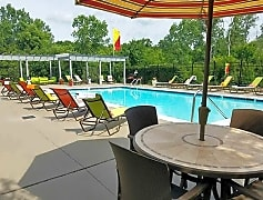 Relax by the pool on our expansive sundeck, complete with loungers and tables with umbrellas.