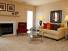 Living Area with Cozy Wood Burning Fireplace  at the Oak Pointe Apartment Homes in Simpsonville , SC
