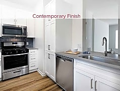 Kitchens Featuring Quartz Countertops, Stainless Steel Appliances, Tile Backsplash, and Hard Surface Vinyl Plank Flooring (Representative Photo)