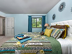 Large bedroom with natural lighting
