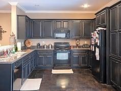 Plenty of cabinets for kitchen storage.