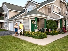 Condo-style community with attached garages, private entries, and yard space