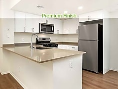 Premium finish kitchen with quartz countertops, stainless appliances, new cabinetry, and hard surface plank flooring (in select homes)