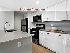Newly renovated kitchen with quartz countertops, stainless steel appliances, new cabinetry, and hard surface vinyl plank flooring (In select apartments)