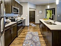 Kitchen island overlooking into living area in 2 bedroom