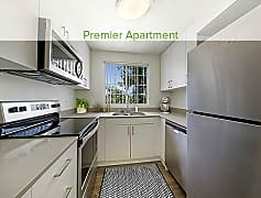 Premier kitchen with quartz countertops, stainless appliances, new cabinetry, and hard surface plank flooring (in select homes)