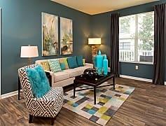 Open floorplan living area with wood-look flooring