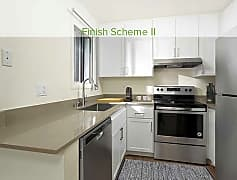 Newly renovated kitchen with quartz countertop, new cabinetry, stainless steel appliances, and hard surface plank flooring (in select homes)