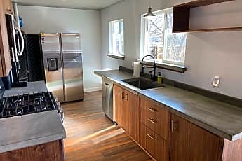 Kitchen with custom walnut cabinets, 415 West Ouray Avenue, 0