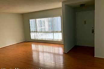 Living Room, 6001 Canterbury Drive Unit 107, 0